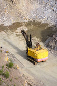 Yellow excavator stonecutter — Stock Photo