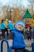 Boy on the carousel — Stock Photo