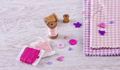 Sewing items with a check fabrics, buttons, thread and pins — Foto de Stock