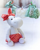 White hippo toy with textile and sewing accessory — Stock Photo