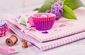 Sewing items with a check fabrics, buttons, thread and pins — Stockfoto