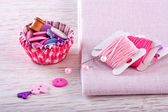 Sewing items with a check fabrics, buttons, thread and pins — Stok fotoğraf