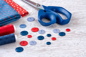 Sewing items with a check fabrics, buttons, thread and pins — Stock fotografie