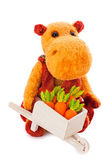 Isolated yellow hippo toy with the cart full of carrot — Stock Photo