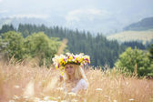 Girl in a wreath on a meadow — Stock Photo