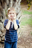 Six Years old Child Kid smiling in the park — Stockfoto