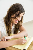 Young business woman writing a report — Stock Photo