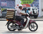 Motorcycle delivery — Stockfoto