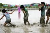 Children playing in the water during the festival — Stock Photo