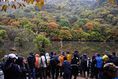 People at autumn landscape with beautiful  Jusanji  lake — Stock Photo