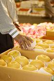 Man takes apple  at Agricultural market — ストック写真