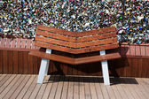 Thousands of love padlocks and a bench in front — Stock Photo