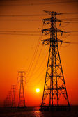 Towers of high woltage lines — Stock Photo