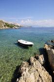 Rowboat on a beautiful sea — Stock Photo