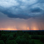 Rainstorm, lightning and sunset — Stock Photo