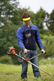 Man working with grass trimmer — Stock Photo