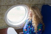 Woman in airplane — Stock Photo