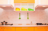 Electric stove on orange kitchen — Stock Photo