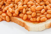 Detail of baked beans on white toast. — Stock Photo