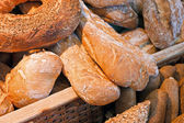 Rustic bread selection in a basket — Stock Photo