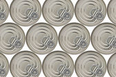 Background of closed cans — Stock Photo