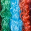 Coloured wigs with long wavy fake hair — Stock Photo #46502033