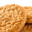 Постер, плакат: Three crispy golden oat biscuits