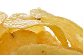 Potato crisps or chips close up on white background — Stock Photo