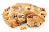 Large light chocolate chip cookie brocken — Stock Photo