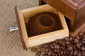 Fresh coffee grinds in coffee grinder box — Stock Photo