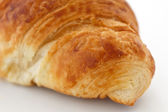 Macro detail of an end of a pastry croissant — Stock Photo