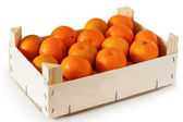 Wooden box filled with tangerines — Foto Stock