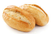 Two crusty mini baguettes on white surface — Stock Photo