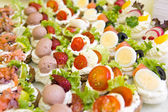 Mixed mini canapes on a plate — Stock Photo