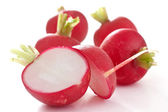 Red radish cut in half on white — Stock Photo