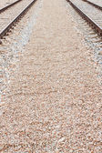 Newly laid train tracks on concrete ballast — 图库照片