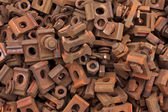 Rusty train track nuts, bolts, washers and clasps — Stock Photo