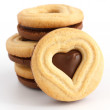 Stack of mixed white and dark biscuits with heart shape cut out. — Stock Photo #49398765