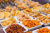 Many types of savoury snack in white dishes — Stock Photo