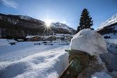 Winter landscape with cross sun — Stock Photo