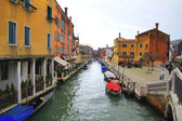 Venice canal and boat — Stock Photo