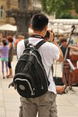 A young man photographed the street musicians — Stock Photo