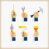 Hand holding tools — Stock Vector