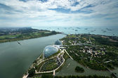 SINGAPORE - SEPTEMBER 16: An aerial view of Singapore river and coast line, buildings and highways on September 16, 2013 in Singapore. Singapore is South East Asia's financial capital. — Stock Photo