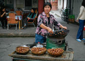 Street food: roast chestnuts — Stock Photo