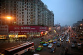 Sichuan, China: Cars and buses line the busy street — Stock Photo