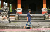 Balinese man walks past a the street — Stock Photo