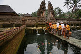 Devotees line up for the cleansing ceremony — Stock Photo