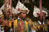 Balinese men dressed as warriors — Stock Photo