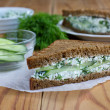 Sandwich with cottage cheese, cucumber and dill — Stock Photo #46557029